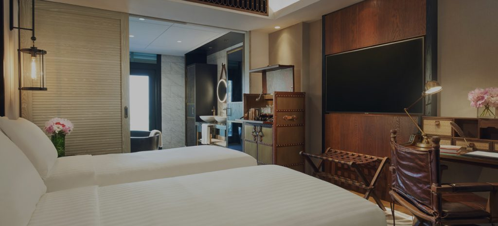 best luxury resorts in singapore barracks sentosa room interior twin bed wooden deco