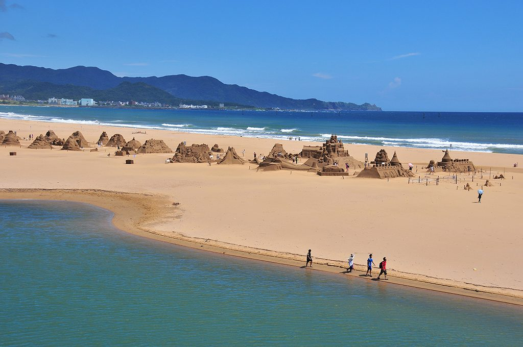 summer getaways throughout the year with sand sculptures in fulong beach taiwan