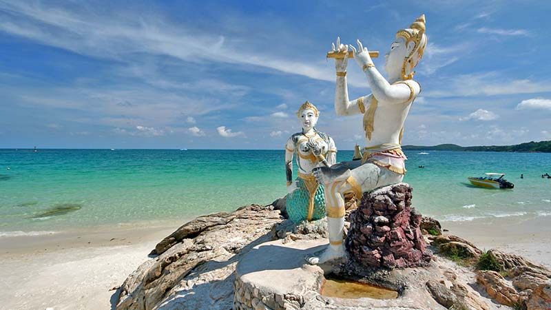 statues atop a rock in koh samet thailand