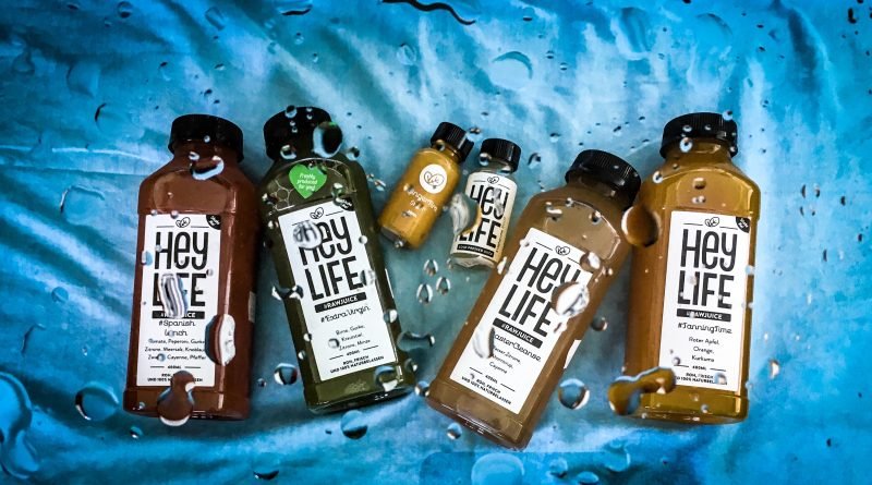 how to do a juice cleanse in summer - selection of heylife raw juice bottles