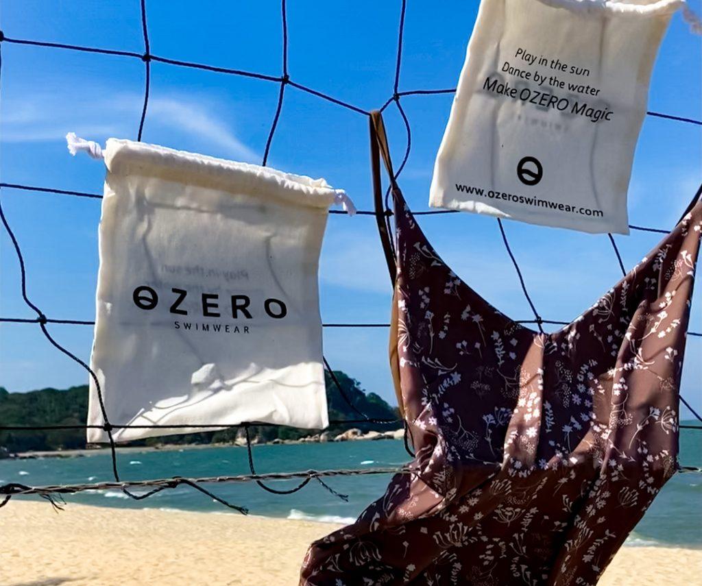 luxury swimwear hanging on a net on the beach